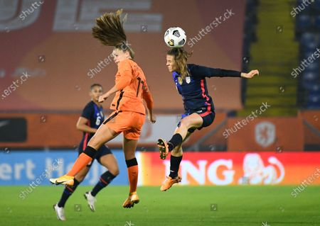 United States' Kelley O'Hara heads the ball as she jumps with Netherlands' Lieke Martens during the international friendly women's soccer match between The Netherlands and the US at the Rat Verlegh stadium in Breda, southern Netherlands