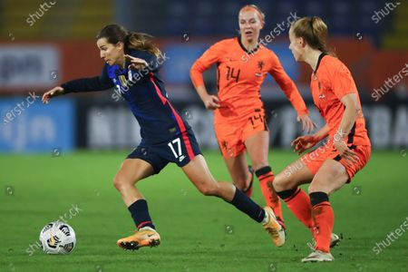 United States' Tobin Heath, left, Netherlands' Jackie Groenen, center, and Netherlands' Lynn Wilms, right, vie for the ball during the international friendly women's soccer match between The Netherlands and the US at the Rat Verlegh stadium in Breda, southern Netherlands