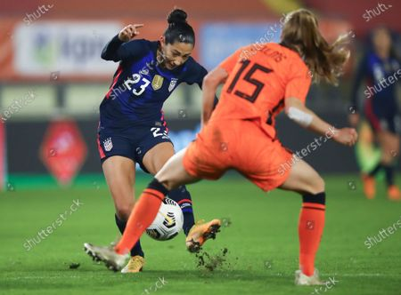 Stock Picture of United States' Christen Press shoots on goal as Netherlands' Lynn Wilms, right, defends during the international friendly women's soccer match between The Netherlands and the US at the Rat Verlegh stadium in Breda, southern Netherlands