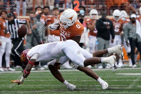 Iowa State defensive back Isheem Young (1) causes Texas wide receiver Tarik Black (0) to fumble the ball during the first half of an NCAA college football game, in Austin, Texas. Iowa State recovered the ball