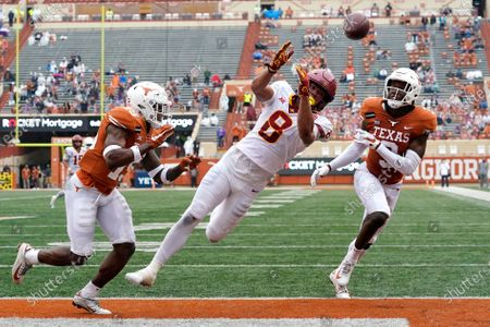 Stock Image of Iowa State wide receiver Xavier Hutchinson (8) fails to make a catch in the end zone as Texas defensive backs Chris Brown, left, and Jalen Green, right, defend during the first half of an NCAA college football game, in Austin, Texas