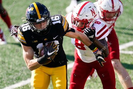 Stock Image of Iowa's Charlie Jones (16) runs from Nebraska's Deontai Williams (8) during a punt return in the first half of an NCAA college football game, in Iowa City, Iowa