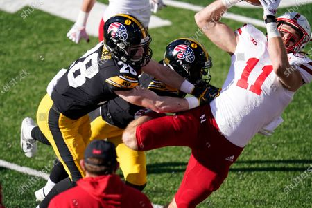 Nebraska tight end Austin Allen (11) catches a pass over Iowa defensive back Jack Koerner (28) during the first half of an NCAA college football game, in Iowa City, Iowa