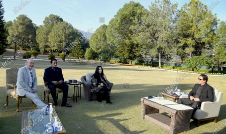 A handout photo made available by the Pakistani Press Information Department shows Pakistan's Prime Minister Imran Khan (R) meeting with American pop icon Cher (2-R), in Islamabad, Pakistan, 27 November 2020. Cher met Pakistan Prime Minister Imran Khan ahead of the relocation of an elephant from Islamabad's dilapidated zoo to a Cambodian sanctuary. Pakistan's only Asian elephant, Kaavan, will be repatriated by 23 November 23, to the elephants' permanent habitat in Cambodia after 35 years in Pakistan. Others are not identified.