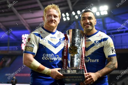 St HelensÕ James Graham and Zeb Taia celebrate with the trophy.