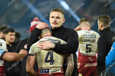 WiganÕs George Burgess consoles Oliver Gildart after the loss.