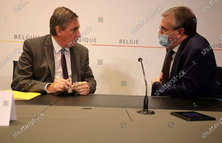 Stock Image of Belgium's Flemish Minister President Jan Jambon, left, speaks with Minister-President of the Wallonie-Bruxelles Region Pierre Yves Jeholet prior to a news conference following a government meeting on the coronavirus, COVID-19, in Brussels