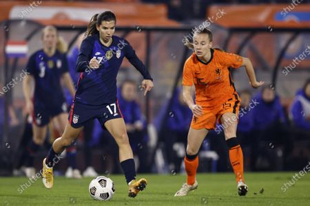 Tobin Heath (L) of USA and Lynn Wilms of Netherlands in action during the women's international friendly soccer match between the Netherlands and the United States at the Rat Verlegh Stadium in Breda, The Netherlands, 27 November 2020.