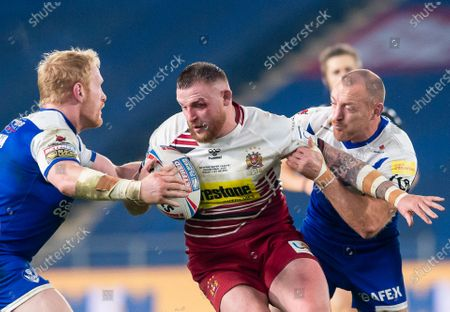 Wigan's Brad Singleton is tackled by St Helens's James Graham & James Roby.