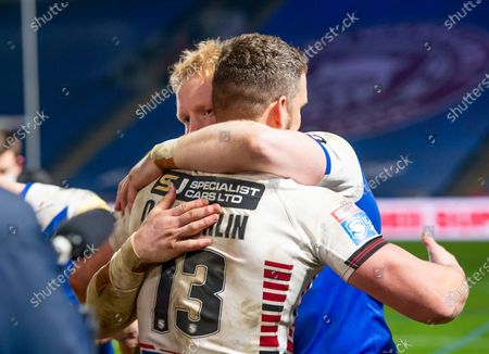 St Helens's James Graham hugs Wigan's Sean O'Loughlin as both players careers ended after the game.