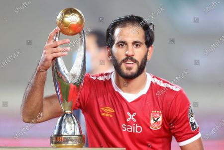 Stock Photo of Al-Ahly player Marwan Mohsen celebrates  after winning  the CAF champion league final  soccer match between Al-Ahly and Zamalek at Cairo Stadium in Cairo Egypt, 27 November 2020.