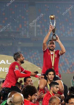 Al-Ahly player Ali Maaloul (top R) celebrates with the trophy after winning the CAF Champions League final soccer match Zamalek vs Al-Ahly at Cairo International Stadium in Cairo, Egypt, 27 November 2020.