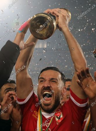 Al-Ahly player Ali Maaloul celebrates with the trophy after winning the CAF Champions League final soccer match Zamalek vs Al-Ahly at Cairo International Stadium in Cairo, Egypt, 27 November 2020.