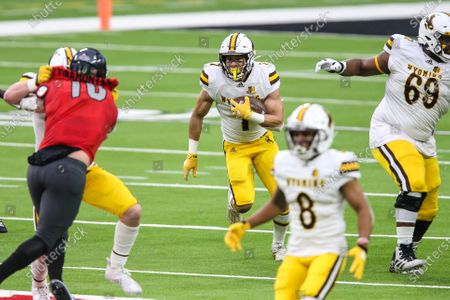 Wyoming Cowboys running back Trey Smith (7) runs with the football during NCAA football game featuring the Wyoming Cowboys and the UNLV Rebels in Las Vegas, NV. The Wyoming Cowboys lead the UNLV Rebels at halftime 17 to 7