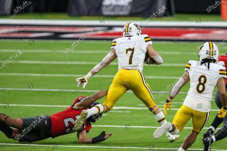 Wyoming Cowboys running back Trey Smith (7) is tackled by UNLV Rebels defensive back Tre Caine (29) during the NCAA football game featuring the Wyoming Cowboys and the UNLV Rebels in Las Vegas, NV. The Wyoming Cowboys defeated the UNLV Rebels 45 to 14