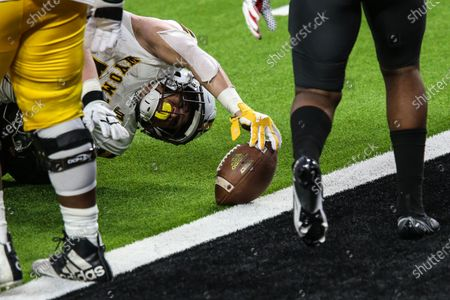 Wyoming Cowboys running back Trey Smith (7) reaches for the endzone during the NCAA football game featuring the Wyoming Cowboys and the UNLV Rebels in Las Vegas, NV. The Wyoming Cowboys defeated the UNLV Rebels 45 to 14