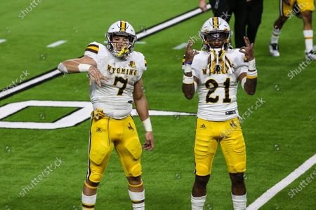 Wyoming Cowboys running back Trey Smith (7) and C.J. Coldon (21) pose for the camera during the NCAA football game featuring the Wyoming Cowboys and the UNLV Rebels in Las Vegas, NV. The Wyoming Cowboys defeated the UNLV Rebels 45 to 14