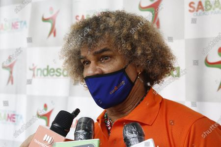 "Stock Picture of Former Colombian soccer player Carlos 'El Pibe' Valderrama (R) speaks with the press during the inauguration of a sports arena, in Sabaneta, Colombia, 27 November 2020. Former Colombian soccer player Carlos Alberto Valderrama affirmed this Friday that Diego Armando Maradona 'is never going to leave' and after his death asked the world to remember him as a ""soccer monster"" and an ""advance"". ""They told me a key phrase: 'Artists never leave. They will always stay.' Diego Maradona is never going to leave,"" Valderrama told reporters during the inauguration of a soccer field in the municipality of Sabaneta, an event during which a minute of silence was held for the Argentine star."