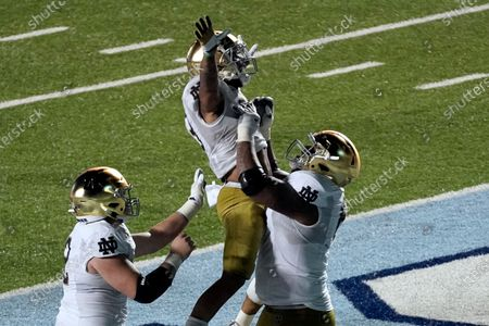 Notre Dame running back Kyren Williams is hoisted by offensive lineman Aaron Banks (69) following Williams' touchdown against North Carolina during the second half of an NCAA college football game in Chapel Hill, N.C