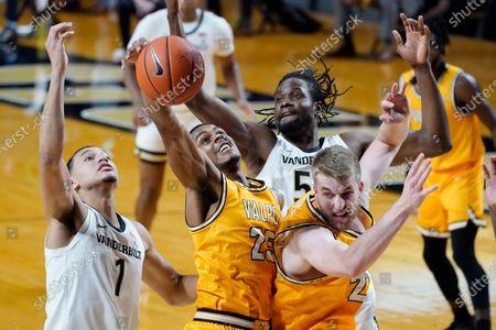 Valparaiso guard Nick Robinson (25) grabs a rebound between Vanderbilt's Dylan Disu (1) and Ejike Obinna (50) in the first half of an NCAA college basketball game, in Nashville, Tenn