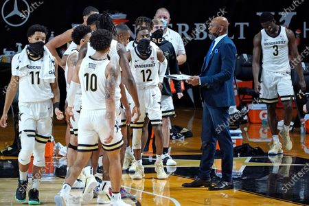 Stock Image of Vanderbilt head coach Jerry Stackhouse talks with his players during a time out in the first half of an NCAA college basketball game against Valparaiso, in Nashville, Tenn