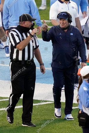 North Carolina head coach Mack Brown speaks with an official during the first half of an NCAA college football game against Notre Dame in Chapel Hill, N.C