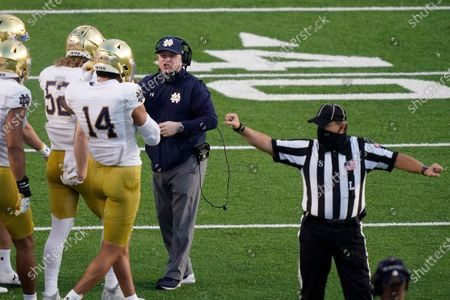 Notre Dame head coach Brian Kelly speaks with his players during the first half of an NCAA college football game against North Carolina in Chapel Hill, N.C