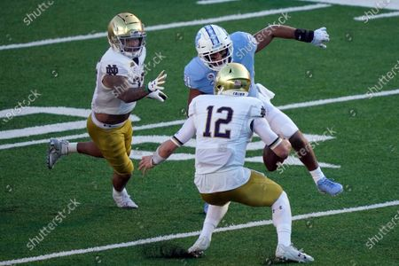 North Carolina linebacker Chazz Surratt (21) rushes Notre Dame quarterback Ian Book (12) during the first half of an NCAA college football game in Chapel Hill, N.C