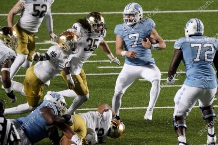 North Carolina quarterback Sam Howell (7) runs against Notre Dame during the second half of an NCAA college football game in Chapel Hill, N.C