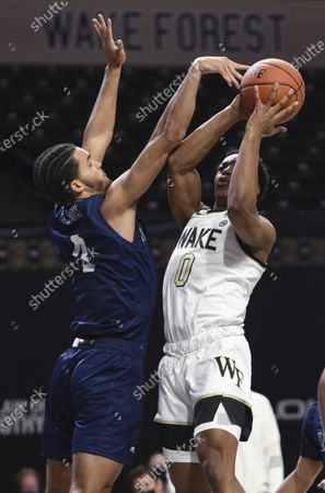 Wake Forest's Jahcobi Neath shoots under pressure from Longwood's Zac Watson during the first half of an NCAA basketball game, in Winston-Salem, N.C