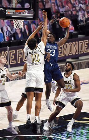 Longwood's Jermaine Drewey shoots under pressure from Wake Forest's Tariq Ingraham during the first half of an NCAA basketball game, in Winston-Salem, N.C