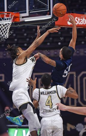 Wake Forest's Jalen Johnson blocks the shot of Longwood's Juan Munoz during the first half of an NCAA basketball game, in Winston-Salem, N.C