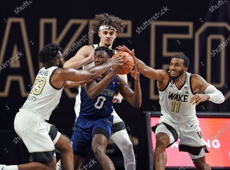 Wake Forest's Isaiah Wilkins (23), Ismael Massoud and Ian DuBose (11) pressure Longwood's Leslie Nkereuwem during an NCAA basketball game, in Winston-Salem, N.C