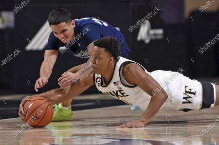Longwood's Juan Munoz, left, and Wake Forest's Johcobi Neath dive for a loose ball during the second half of an NCAA basketball game, in Winston-Salem, N.C