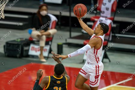 Wisconsin's D'Mitrik Trice (0) goes for a layup against Arkansas-Pine Bluff's Shaun Doss (21) during the first half of an NCAA college basketball game, in Madison, Wis