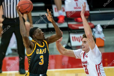 Arkansas-Pine Bluff's Markedric Bell (3) shoots against Wisconsin's Nate Reuvers (35) during the first half of an NCAA college basketball game, in Madison, Wis