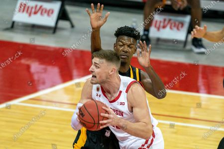 Wisconsin's Micah Potter, front, goes up against Arkansas-Pine Bluff's Alvin Stredic during the first half of an NCAA college basketball game, in Madison, Wis
