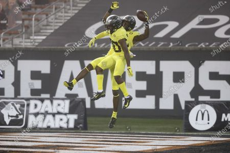 Oregon wide receivers Devon Williams, rear, and Jaylon Redd (30) celebrate Williams' touchdown during the first half of the team's NCAA college football game against Oregon State in Corvallis, Ore