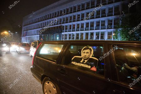 A poster of Slovenian president Borut Pahor and a hashtag asking about his whereabouts, referring to his silence about Prime minister Jansaís recent behavior and actions, is seen fitted on a back window of a car during a drive-by anti-government protest. Anti-government protests in the Slovenian capital continued with protesters who previously cycled around government buildings now driving in their cars in order to respect the covid-19 epidemic restrictions, especially the country's ban on gatherings that are subject to very big fines. Many were nevertheless booked and fined by the police, what many take as yet another government's move to criminalize the protests.