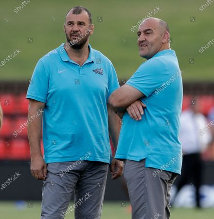 Argentina coach Mario Ledesma, right, stands with assistant Michael Cheika ahead of the Tri-Nations rugby test between Argentina and the All Blacks in Newcastle, Australia