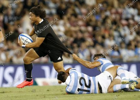 Caleb Clarke of the All Blacks slips through the Pumas defence during the Tri Nations rugby match between the Argentina Pumas and New Zealand All Blacks at McDonald Jones Stadium in Newcastle, Australia, 28 November 2020.