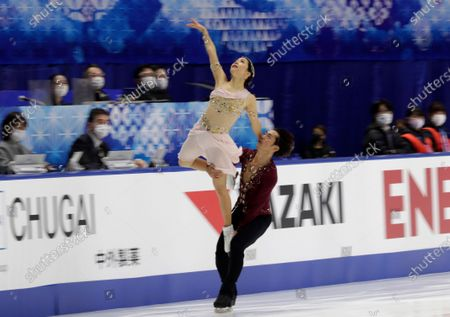 Kana Muramoto, left, and Daisuke Takahashi of Japan perform during a free dance of an ISU Grand Prix of Figure Skating competition in Kadoma, near Osaka, Japan