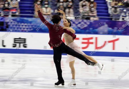 Daisuke Takahashi, left, and Kana Muramoto of Japan perform during a free dance of an ISU Grand Prix of Figure Skating competition in Kadoma near Osaka, Japan