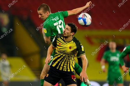 Stock Photo of Emil Riis Jakobsen of Preston North End flicks the ball over Craig Cathcart of Watford; Vicarage Road, Watford, Hertfordshire, England; English Football League Championship Football, Watford versus Preston North End.