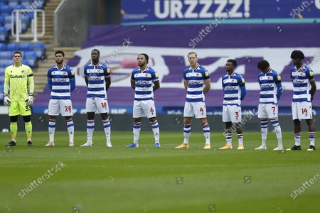 Stock Picture of Goalkeeper Rafael, Josh Laurent, Lucas Joao, Liam Moore, Michael Morrison, Omar Richards, Michael Olise and Ovie Ejaria of Reading stand for a two minute silence in remembrance for the 1986 World Cup winner Diego Maradona who died recently; Madejski Stadium, Reading, Berkshire, England; English Football League Championship Football, Reading versus Bristol City.
