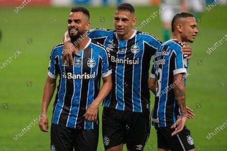 Maicon of Gremio celebrates his goal with Diego Souza and Luiz Fernando in the 65th minute for 2-0; Arena de Gremio, Porto Alegre, Brazil; Brazilian Serie A, Gremio versus Goias.