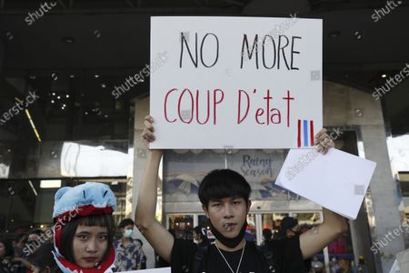 Thai anti-government protesters hold up a placard during a street protest calling for political and monarchical reform in Bangkok, Thailand, 28 November 2020. Thailand has been facing political turmoil amid months-long street protests calling for the political and monarchical reform and the resignation of the prime minister Prayuth Chan-ocha.