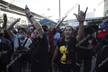 Thai anti-government protesters shout slogans and flash three-finger salutes during a street protest calling for political and monarchical reform in Bangkok, Thailand, 28 November 2020. Thailand has been facing political turmoil amid months-long street protests calling for the political and monarchical reform and the resignation of the prime minister Prayuth Chan-ocha.