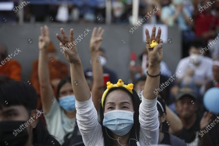 A Thai anti-government protester holds a rubber-duck and flashes a three-finger salute during a street protest calling for political and monarchical reform in Bangkok, Thailand, 28 November 2020. Thailand has been facing political turmoil amid months-long street protests calling for the political and monarchical reform and the resignation of the prime minister Prayuth Chan-ocha.