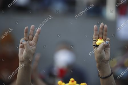 A Thai anti-government protester holding a rubber duck flashes a three-finger salute during a street protest calling for political and monarchical reform in Bangkok, Thailand, 28 November 2020. Thailand has been facing political turmoil amid months-long street protests calling for the political and monarchical reform and the resignation of the prime minister Prayuth Chan-ocha.